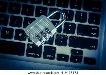 unlock security lock on computer keyboard - computer security breach concept