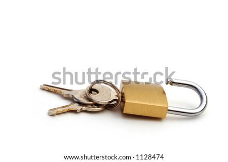 unlocked golden lock with keys - stock photo