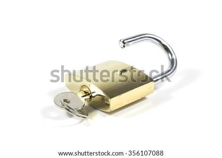 Unlocked Golden Padlock And Key Isolated On White Background, Closeup - stock photo