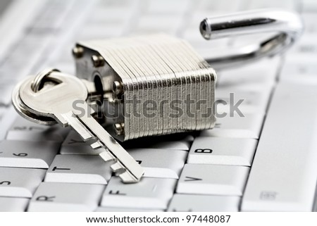 unlocked paddock on computer keyboard - stock photo