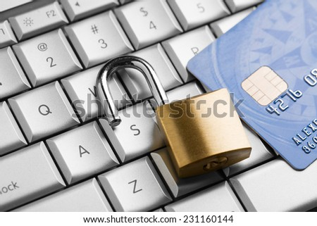Unlocked padlock on a credit card on keyboard