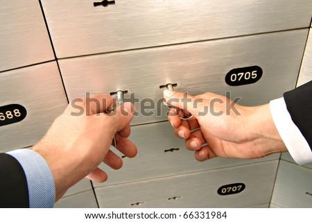 unlocking deposit safe - stock photo