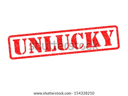 unlucky rubber stamp over a white background stock photo