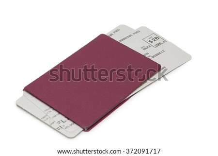 Unmarked red passport with two flight tickets isolated on white background