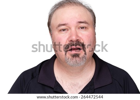 Unmotivated lethargic middle-aged man with a goatee beard looking a the camera with a dim-witted expression and his mouth ajar, isolated on white
