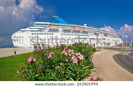 Unnamed cruiser docked on waterfront, nature, architecture and ship view - stock photo