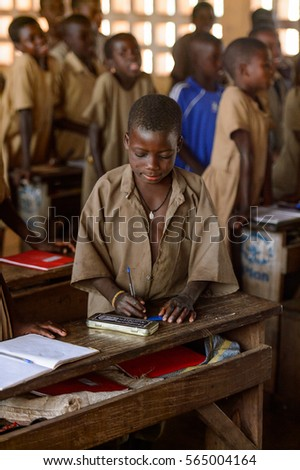 UNNAMED ROAD, TOGO - JAN 12, 2017: Unidentified Togolese boy on the lesson in a local primary school. All subjects are in French language in Togo