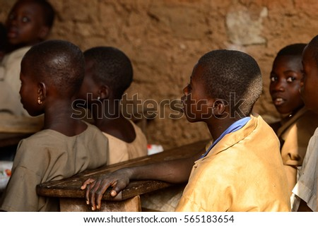 UNNAMED ROAD, TOGO - JAN 12, 2017: Unidentified Togolese children on the lesson in a local primary school. All subjects are in French language in Togo