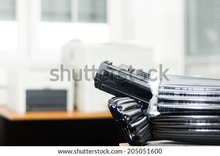 Unpacking toner cassete - stock photo