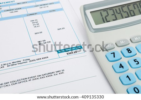 Unpaid utility bill and calculator over it series - stock photo