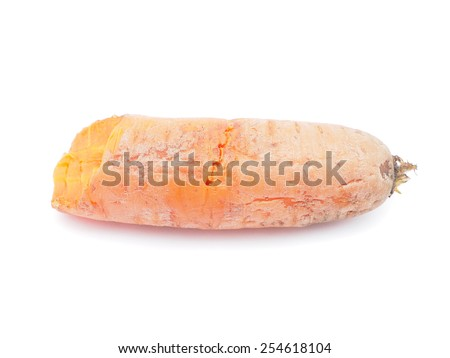 unpeeled carrots on a white background