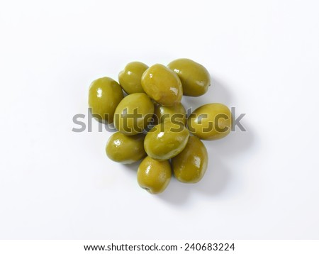 Unpitted brine cured green olives - stock photo