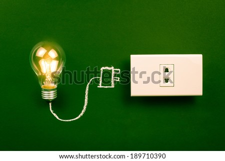 Unplugged light bulb still shining, energy saving creation or business idea concept - stock photo