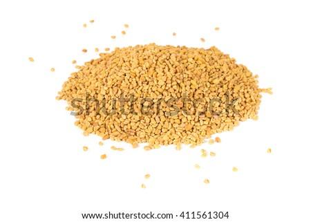 Unprocessed whole fenugreek (Trigonella foenum-graecumcumin) seeds heap over white background - stock photo