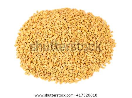 Unprocessed whole fenugreek (Trigonella foenum-graecumcumin) seeds heap over white background