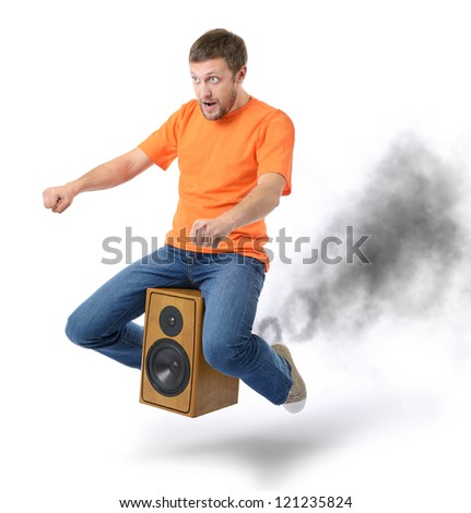 unreal flying man on the speaker with smoke, motor sound concept - stock photo