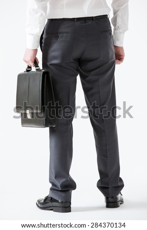Unrecognizable assured young businessman, rear view