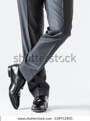 Unrecognizable assured young businessman, white background