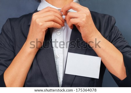 Unrecognizable business woman with empty badge on the chest, space for text - stock photo