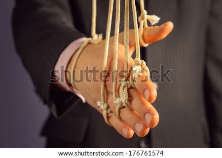 Unrecognizable businessman gives a handshake, hand on the ropes - stock photo