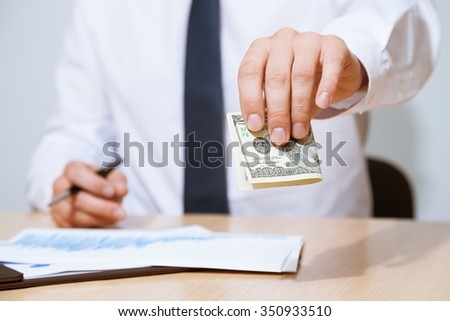 Unrecognizable businessman giving a hundred dollars, closeup shot