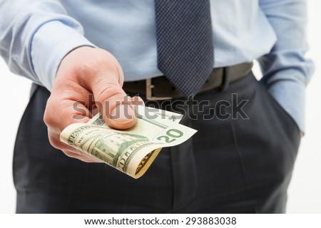 Unrecognizable businessman holding twenty dollars - closeup shot - stock photo