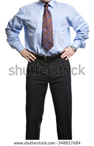 Unrecognizable businessman in blue shirt stands with hands on the waist