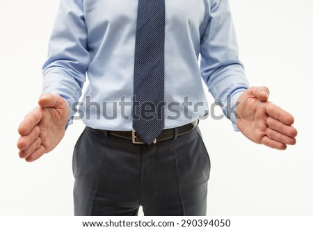 Unrecognizable businessman showing interval between his palms, white background - stock photo
