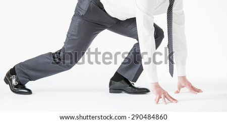 Unrecognizable businessman waiting by the starting line, white background - stock photo
