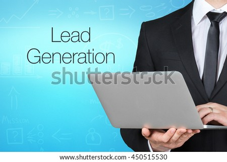 Unrecognizable businessman with laptop standing near text - lead generation - stock photo