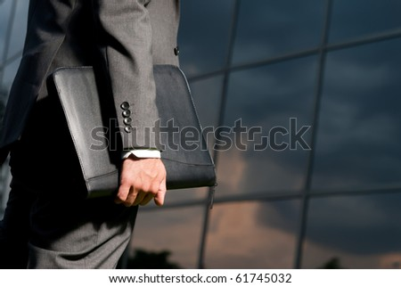 Unrecognizable businessman with suitcase working late concept