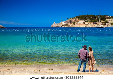 unrecognizable couple enjoying beautiful view of the harbour of Port de Soller, Majorca, Spain - stock photo