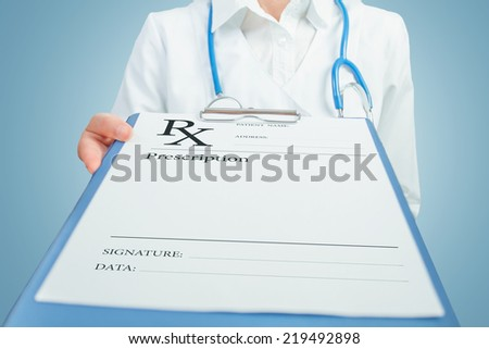 Unrecognizable female doctor gives clipboard with prescription paper