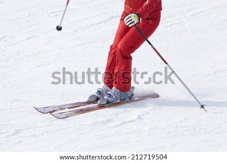 unrecognizable female skier on ski resort - stock photo