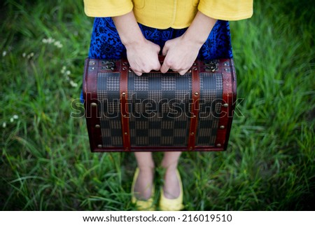 unrecognizable girl holding retro vintage suitcase, travel concept, change and move concept - stock photo