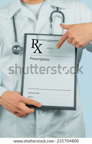 Unrecognizable man doctor pointing on clipboard with prescription paper