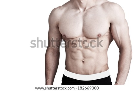 Unrecognizable muscular man with sixpack - isolated on white - stock photo
