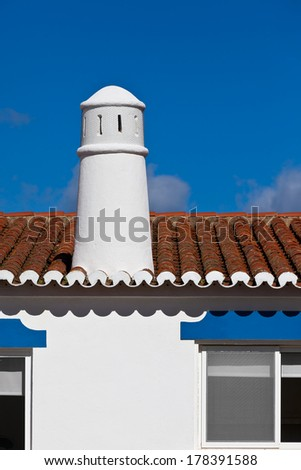 Unrecognizable Part of Residential House at Algarve, Portugal. Bright Blue Sky as a Background