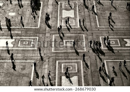Unrecognizable: People visible only as Silhouettes and shadows in Urban Environment - stock photo