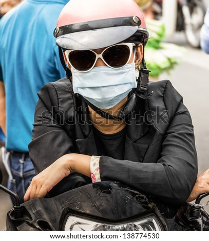 Unrecognizable Person with a Smog Face Mask - stock photo