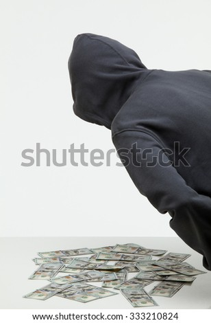 Unrecognizable robber stealing money, white background