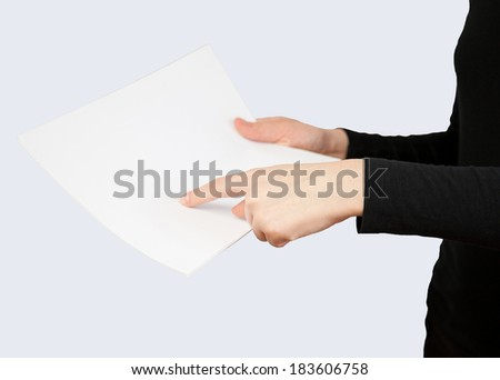 Unrecognizable woman holding empty paper, white background