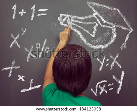 Unrecognizable woman is drawing lightbulb and formulas on the blackboard, concept of education - stock photo