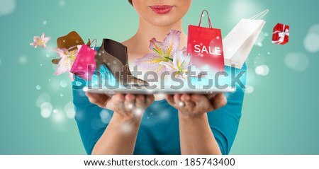 Unrecognizable woman shopping online using her tablet computer - stock photo