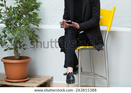 unrecognizable young business woman using her smartphone outdoors.shallow depth of field with focus on the hand - stock photo