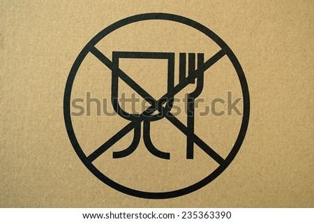 Unsafe materials for food contact warning sign, printed on a cardboard box