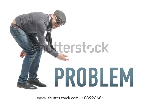Unshaven bald man wearing a cap, jeans, sunglasses and scarf crouched and points to the inscription PROBLEM. Isolated - stock photo