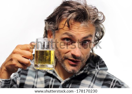 unshaven man drinking beer - stock photo