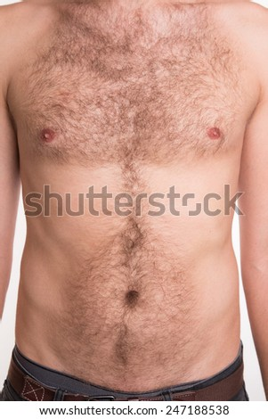 Unshaven man's chest and abdomen - studio shoot