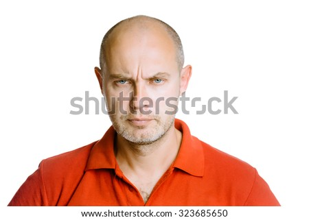 Unshaven man scowling. Isolated on white. Studio - stock photo